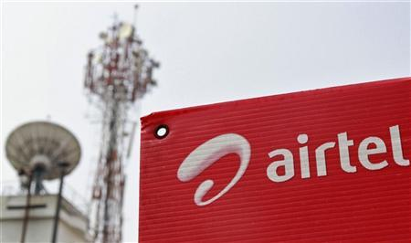 A Bharti Airtel advertisement board is installed against the backdrop of company's telecommunication tower in Kochi November 30, 2012. REUTERS/Sivaram V/Files