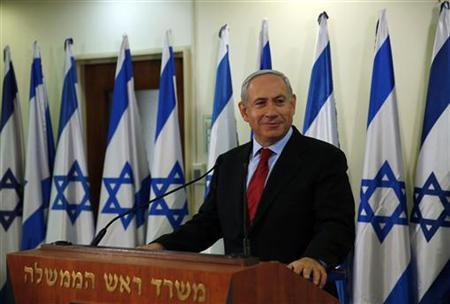 Israel's Prime Minister Benjamin Netanyahu pauses while delivering a statement at his office in Jerusalem January 23, 2013. REUTERS/Darren Whiteside