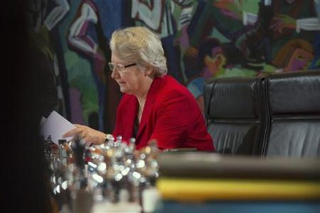 Germany's Education Minister Annette Schavan reads before a cabinet meeting at the Chancellery in Berlin December 19, 2012. REUTERS/Thomas Peter (GERMANY - Tags: POLITICS EDUCATION)