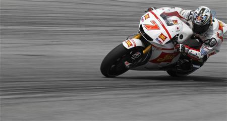 Honda MotoGP rider Hiroshi Aoyama of Japan takes a corner during the third free practice session at the Malaysian Grand Prix at Sepang International Circuit near Kuala Lumpur October 22, 2011. REUTERS/Stringer