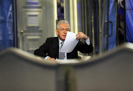 Italy's Prime Minister Mario Monti speaks during an interview as a guest on the RAI television Porta a Porta (Door to Door) in Rome January 14, 2013. REUTERS/Alessandro Bianchi