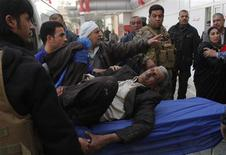 A man wounded by a suicide bomber in Tuz Khurmato city, is treated at a hospital in Kirkuk, 250 km (155 miles) north of Baghdad, January 23, 2013. REUTERS/Ako Rasheed