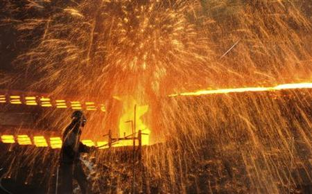 A labourer works at a steel factory in Dalian, Liaoning province December 4, 2012. REUTERS/China Daily/Files