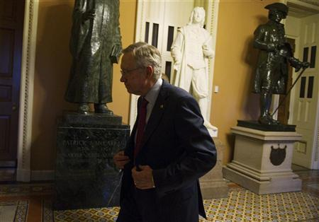U.S. Senate Majority Leader Harry Reid (D-NV) walks to his office at the U.S. Capitol after returning from a meeting with President Barack Obama at the White House in Washington December 28, 2012. REUTERS/Mary Calvert