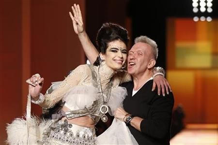 French designer Jean Paul Gaultier (R) appears with a model at the end of his Haute Couture Spring-Summer 2013 fashion show in Paris January 23, 2013. REUTERS/Benoit Tessier