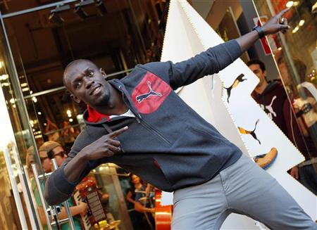 Jamaica's double Olympic champion sprinter Usain Bolt strikes a pose while inaugurating a Puma store in Barcelona November 23, 2012. REUTERS/Albert Gea