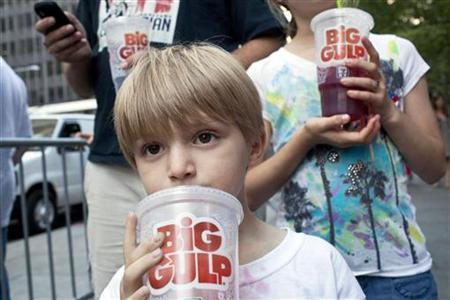 Benjamin Lesczynski, 8, of New York, takes a sip of a ''Big Gulp'' while protesting the proposed ''soda-ban,'' that New York City Mayor Michael R. Bloomberg has suggested, outside City Hall in New York July 9, 2012. REUTERS/Andrew Burton