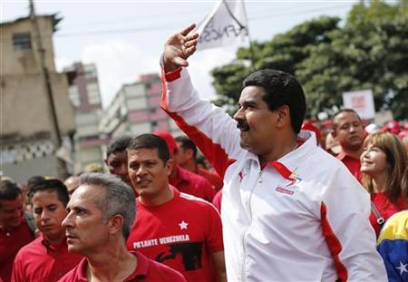 Venezuela's Vice President Nicolas Maduro (R) greets supporters during a rally to commemorate the 55th anniversary of the collapse of the last Venezuelan dictatorship in Caracas January 23, 2013. REUTERS/Jorge Silva