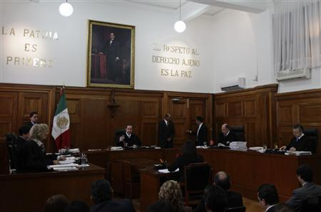 The judges of a Supreme Court panel (L-R) Olga Sanchez Cordero, Alfredo Ortiz Mena, Jorge Mario Rebolledo, Jose Ramos Cossio Diaz and Arturo Zaldivar Lelo de Larrea, meet to review the case of French national Florence Cassez, at the Supreme Court in Mexico City January 23, 2013. REUTERS/Henry Romero (MEXICO - Tags: POLITICS CRIME LAW)