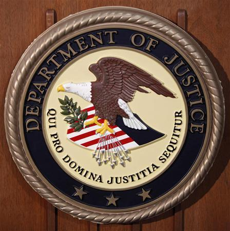 The Department of Justice logo is seen on the podium during a news conference on the Gozi Virus in New York January 23, 2013. REUTERS/Carlo Allegri