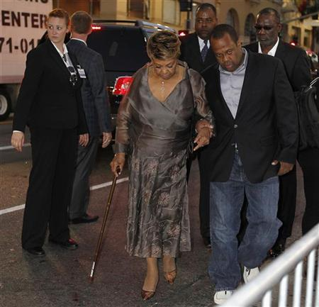 Cissy Houston, mother of the late singer Whitney Houston, is escorted as she bypasses the red carpet at the premiere of the new film ''Sparkle'' in Hollywood, California August 16, 2012. Houston's son Gary Houston (R) is seen walking behind her. REUTERS/Fred Prouser