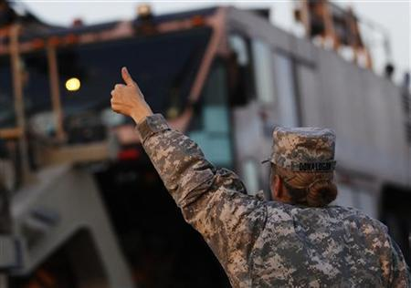 U.S. Army convoys are given the thumbs up from a fellow soldier after crossing into Kuwait during the last convoy out of Iraq December 18, 2011. REUTERS/Shannon Stapleton