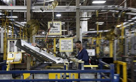 A UAW local 588 assembly worker moves automobile parts around at the Ford Motor Company's Chicago Stamping facility in Chicago Heights, Illinois April 4, 2012. REUTERS/Jeff Haynes