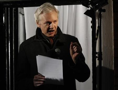 WikiLeaks founder Julian Assange makes a speech from the balcony of Ecuador's Embassy, in central London December 20, 2012. REUTERS/Luke MacGregor/Files