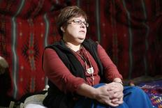 Attawapiskat Chief Theresa Spence speaks with journalists about her hunger strike in a teepee on Victoria Island in Ottawa December 27, 2012. REUTERS/Chris Wattie