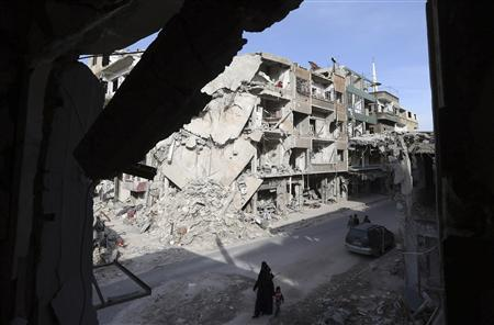 Buildings destroyed by Syrian air force air strikes are seen in Duma neighbourhood, Damascus January 23, 2013. REUTERS/Goran Tomasevic