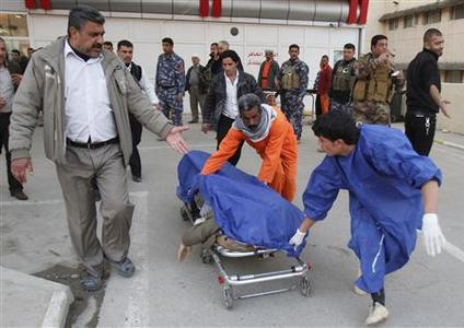 Medical personnel wheel the body of a victim killed by a suicide bomber in Tuz Khurmato city, into a hospital in Kirkuk, 250 km (155 miles) north of Baghdad, January 23, 2013. REUTERS/Ako Rasheed
