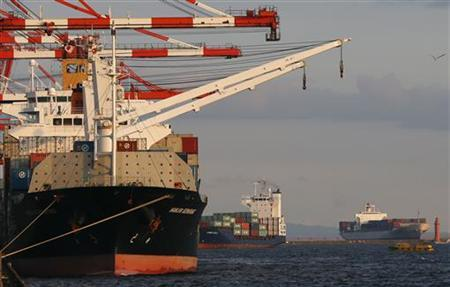 Container ships are seen at an industrial port in Tokyo August 31, 2012. REUTERS/Kim Kyung-Hoon