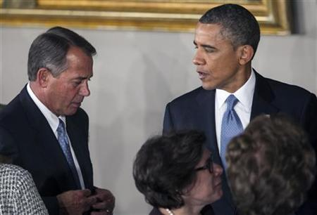 U.S. President Barack Obama talks with Speaker of the House John Boehner (R-OH) at the conclusion of the Inaugural luncheon in Statuary Hall after his ceremonial swearing in at the U.S. Capitol on Capitol Hill in Washington, January 21, 2013. REUTERS/Benjamin Myers