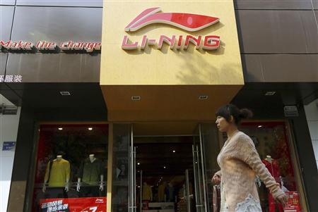 A woman walks past a Li Ning sportswear store in Huaibei, Anhui province in this October 17, 2012 file photograph. REUTERS/China Daily/Files