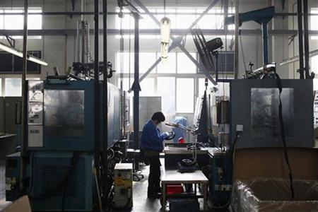 A worker examines a product at a plastics factory on the outskirts of Shanghai December 14, 2012. REUTER/Aly Song