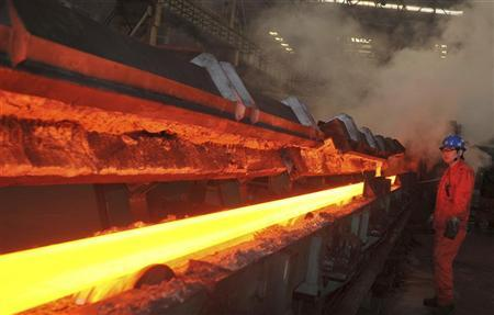An employee works at a steel factory of Dongbei Special Steel Group in Dalian, Liaoning province January 18, 2013. REUTERS/China Daily