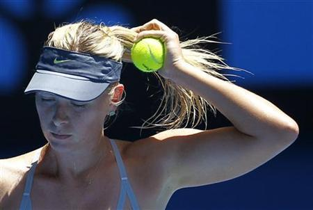Maria Sharapova of Russia adjusts her hair before serving to Li Na of China during their women's singles semi-final match at the Australian Open tennis tournament in Melbourne, January 24, 2013. REUTERS/Navesh Chitrakar