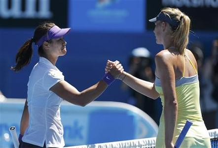 Li Na of China (L) shakes hands with Maria Sharapova of Russia after defeating her in their women's singles semi-final match at the Australian Open tennis tournament in Melbourne January 24, 2013. REUTERS/Damir Sagolj