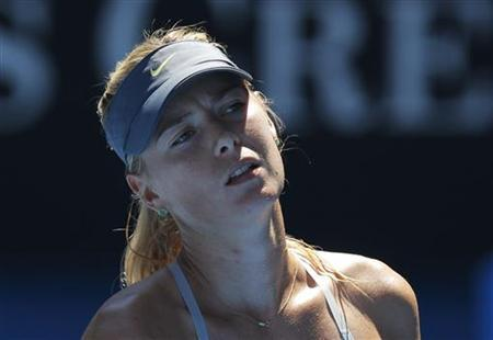 Maria Sharapova of Russia reacts during her women's singles semi-final match against Li Na of China at the Australian Open tennis tournament in Melbourne January 24, 2013. REUTERS/Damir Sagolj