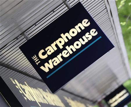 A Carphone Warehouse sign hangs outside a branch in west London May 8, 2009. REUTERS/Toby Melville