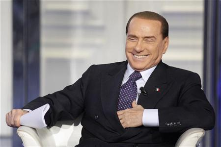 Italy's former Prime Minister Silvio Berlusconi smiles as he appears as a guest on the RAI television show Porta a Porta (Door to Door) in Rome January 9, 2013. REUTERS/Remo Casilli