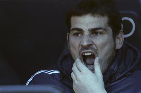 Real Madrid's goalkeeper Iker Casillas reacts before their Spanish first division soccer match against Real Sociedad at Santiago Bernabeu stadium in Madrid January 6, 2013. REUTERS/Juan Medina