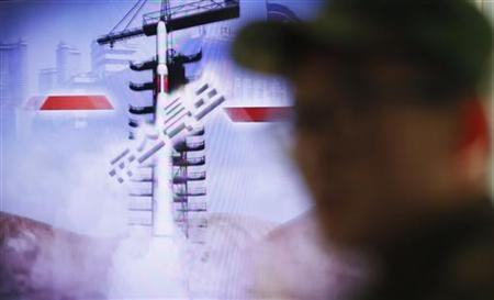 A South Korean soldier watches a television report on North Korea's rocket launch, at Seoul railroad station in Seoul December 12, 2012. REUTERS/Lee Jae-Won