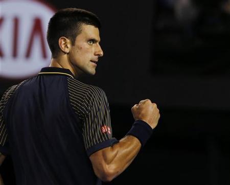 Novak Djokovic of Serbia celebrates breaking David Ferrer of Spain's serve in the third set during their men's singles semi-final match at the Australian Open tennis tournament in Melbourne January 24, 2013. REUTERS/Damir Sagolj