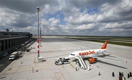An easyJet Airbus A320 'Willy Brandt' is pictured during a name giving ceremony at the airport terminal of Berlin Brandenburg international airport Willy Brandt (BER) in Schoenefeld south of Berlin, April 23, 2012. REUTERS/Fabrizio Bensch (GERMANY - Tags: TRANSPORT)