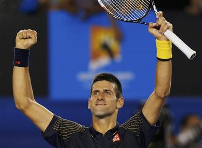 Novak Djokovic of Serbia celebrates defeating David Ferrer of Spain in their men's singles semi-final match at the Australian Open tennis tournament in Melbourne January 24, 2013. REUTERS/Damir Sagolj