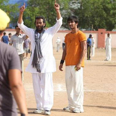 A still from the making of the film 'Kai Po Che' with director Abhishek Kapoor in white overalls (foreground). REUTERS/Handout