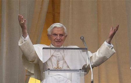 Pope Benedict XVI waves as he leads his Angelus prayer from the window of his private apartment in Saint Peter's Square at the Vatican January 20, 2013. REUTERS/Tony Gentile