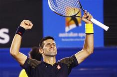 Novak Djokovic of Serbia celebrates defeating David Ferrer of Spain in their men's singles semi-final match at the Australian Open tennis tournament in Melbourne January 24, 2013. REUTERS/Navesh Chitrakar