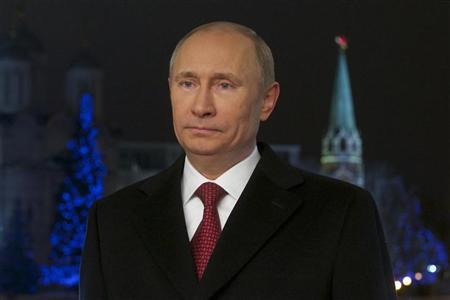 Russian President Vladimir Putin looks on during the recording of the traditional televised New Year's address to the nation in Moscow, December 27, 2012. REUTERS/Alexander Zemlianichenko/Pool