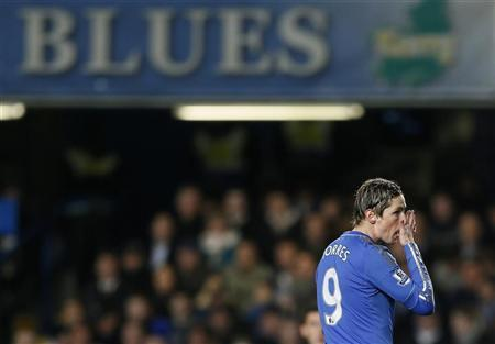 Chelsea's Fernando Torres reacts during their League Cup semi-final match against Swansea City at Stamford Bridge in London January 9, 2013. REUTERS/Stefan Wermuth