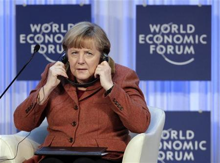 German Chancellor Angela Merkel uses headphone during the annual meeting of the World Economic Forum (WEF) in Davos January 24, 2013. REUTERS/Denis Balibouse