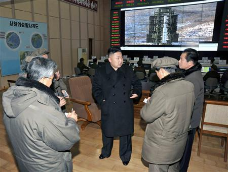 North Korean leader Kim Jong-un (C) visits the West Sea Satellite Launch Site in Cholsan county, North Pyongan province, where the North launched the Unha-3 (Milky Way 3) rocket carrying the second version of the Kwangmyongsong-3 satellite, in this undated picture released by the North's KCNA news agency December 15, 2012. REUTERS/KCNA/Files