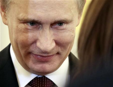 Russian President Vladimir Putin smiles during a ceremony, in which the diplomatic credentials of newly appointed ambassadors were accepted, at the Kremlin in Moscow January 24, 2013. REUTERS/Mikhail Metzel/Pool