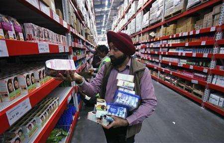 A customer shops at a Best Price Modern Wholesale store, a joint venture of Wal-Mart Stores Inc and Bharti Enterprises, at Zirakpur in the northern Indian state of Punjab December 6, 2012. REUTERS/Ajay Verma/Files