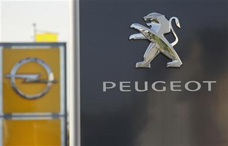 The logos of German General Motors daughter Opel and French car maker Peugeot are seen at a Opel and Peugeot dealership in Leverkusen near Cologne October 22, 2012. Picture taken October 22. REUTERS/Wolfgang Rattay (GERMANY)