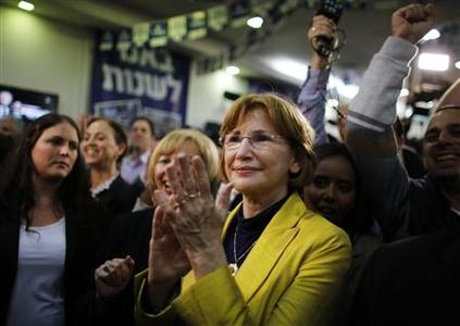 Yael German, mayor of Herziliya and a Yesh Atid (There's a future) party candidate, celebrates exit poll results at the party's headquarters in Tel Aviv January 22, 2013. REUTERS/Ammar Awad
