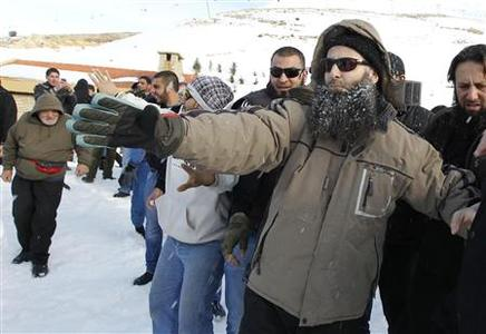Sunni Muslim Salafist leader Ahmad al-Assir engages in a snowball fight with his supporters in the Faraya ski area in Mount Lebanon January 24, 2013. REUTERS/Mohamed Azakir