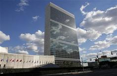 Clouds are reflected off the Secretariat Building (C) of the UN headquarters during the 67th United Nations General Assembly, in New York, September 24, 2012. REUTERS/Chip East