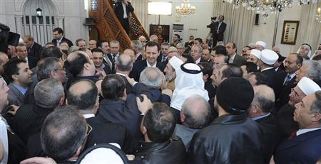 Syria's President Bashar al-Assad (C) greets people after attending prayers during celebrations of Prophet Mohammed's birthday at the al-Afram mosque in Damascus January 24, 2013, in this handout picture provided by Syria's national news agency SANA. REUTERS/SANA/Handout